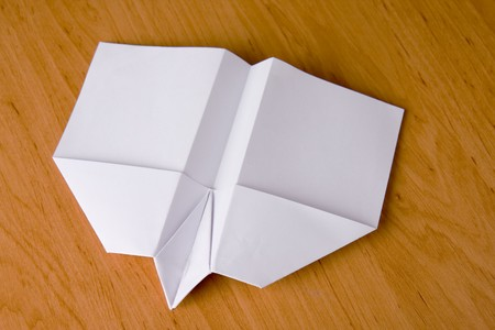 white paper plane on table Stock Photo - 4564051