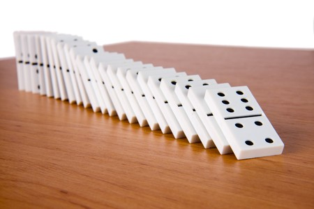 gambling stone: line of domino on table