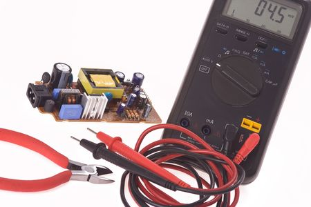 the digital multimeter and electronics components photo