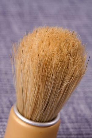 old shaving brush on blue background photo