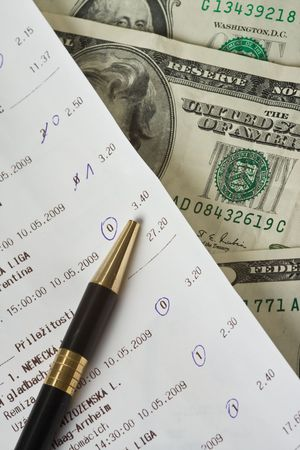 close up of sports betting slip and pencil    photo