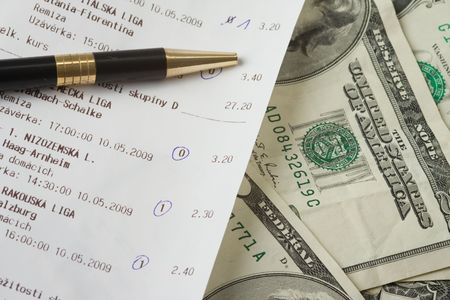 betting: close up of sports betting slip and pencil