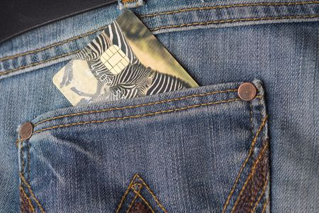 credit card in jeans pocket photo