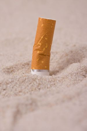 cigarette in sand Stock Photo - 5050055