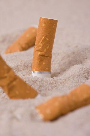 cigarettes in sand Stock Photo - 5050050