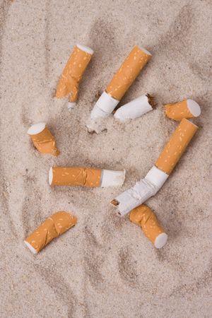 cigarettes in sand Stock Photo - 5050052