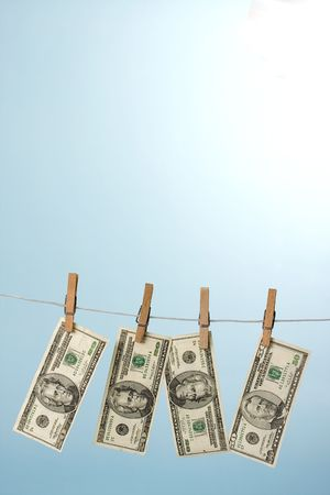 dollars hanging on line on blue background photo