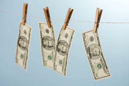 dollars hanging on line on blue background photo