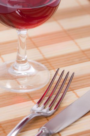 fork and knife on a placemat photo