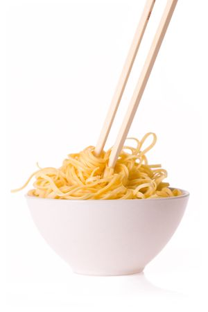chinese noodles: chopsticks,bowl and noodles on white background Stock Photo