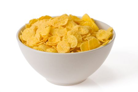 cornflakes in bowl on white background Stock Photo - 5396744