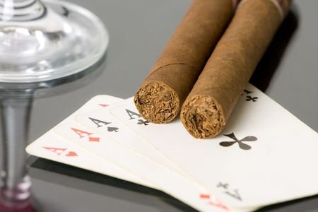 aces,drink and cigar on black background photo