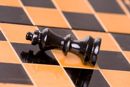 one figure of chess on chessboard photo