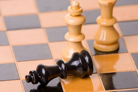 figures of chess on chessboard photo