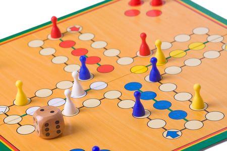 juego: el juego de mesa con peones de color Foto de archivo