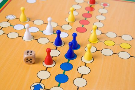 the board game with color pawns photo
