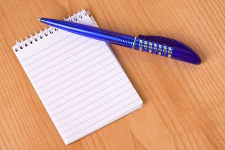 pen and notebook on white background photo