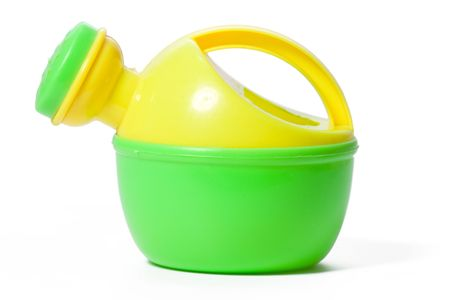 toy plastic watering can isolated on white  photo