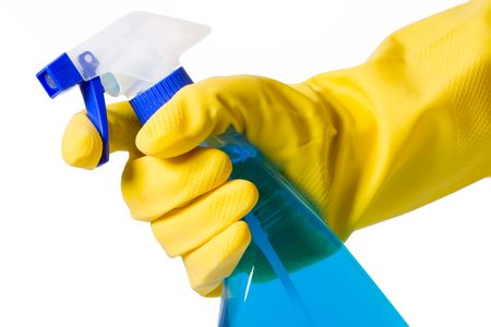 hand in glove with spray bottle on white background photo