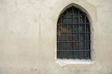 the antique window in stone wall photo