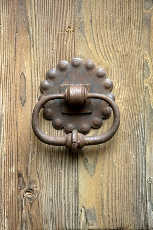 antique keyhole: the old rusty doorknob and wood door