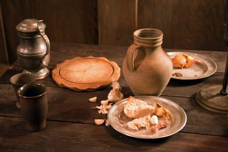 holy jug: medieval feast.a lot of food and drink Stock Photo