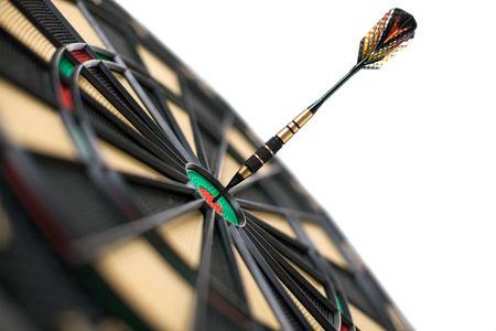 red dart on bullseye isolated on white background    photo