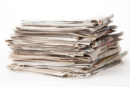 stack of newspapers isolated of white background photo