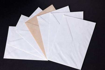 closed envelopes with white spot light on black background photo
