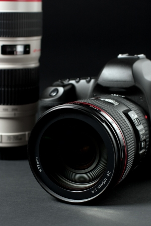 digital camera: low key professional digital SLR camera Stock Photo