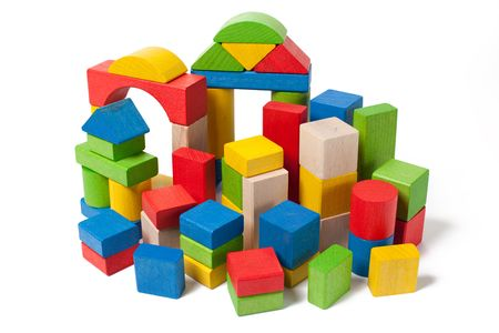 city of colorful wooden toy blocks isolated on white background photo