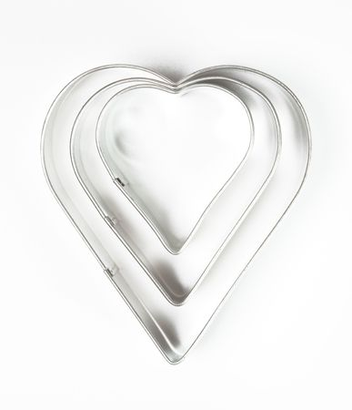 cookie cutters on white background photo