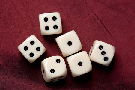 odds: the dice on red fabric Stock Photo