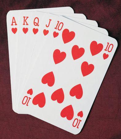 poker cards. royal flush on red background photo