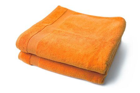 orange towels on white background photo