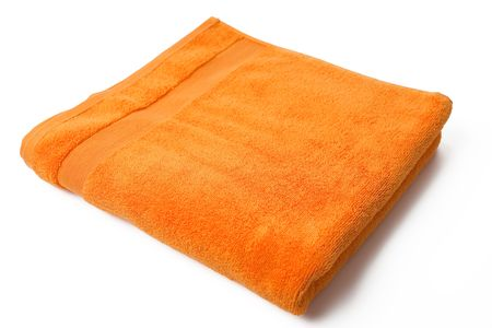 orange towel on white background photo
