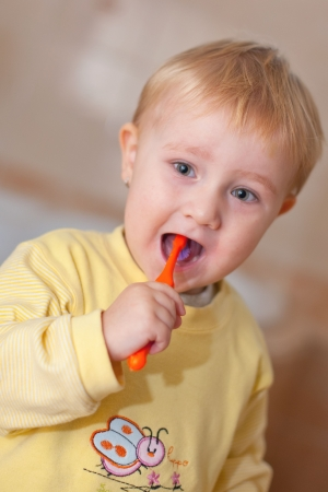 the little cute child brushing her teeth Stock Photo - 5979383