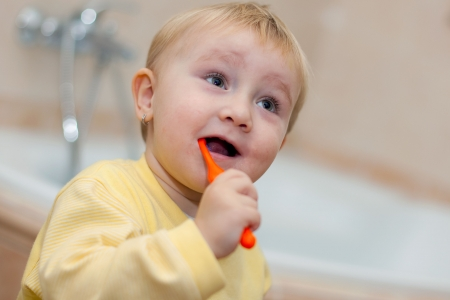 the little cute child brushing her teeth  photo