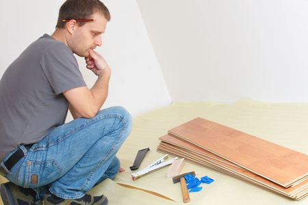 Carpenter laying laminate floor  Stock Photo - 6050563