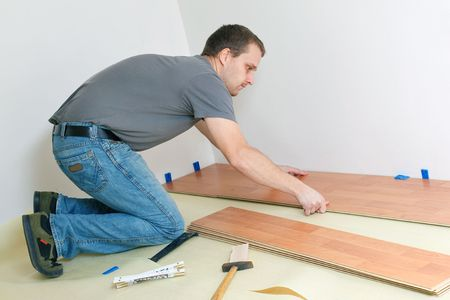 Carpenter laying laminate floor Stock Photo - 6050548