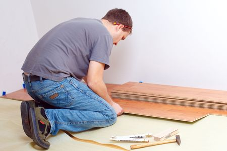 Carpenter laying laminate floor Stock Photo - 6050558