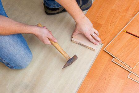 Carpenter laying laminate floor Stock Photo - 6050597