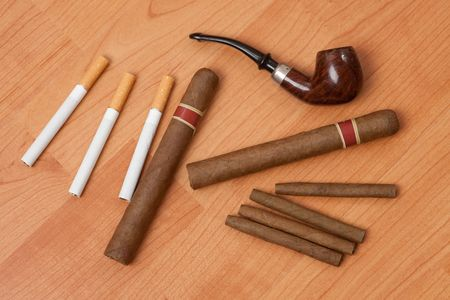 cheroot: smoking accessories on wooden background