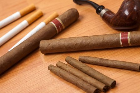 smoking accessories on wooden background photo