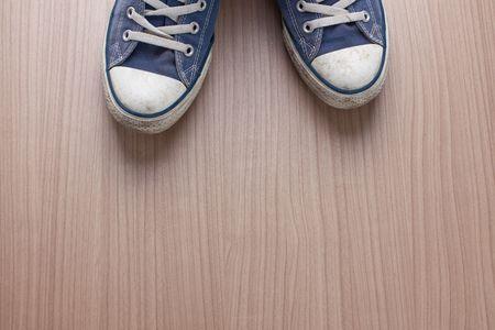 pair of blue sneakers on wooden floor Stock Photo - 6119081