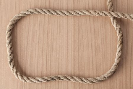 frame make from rope on wooden background photo