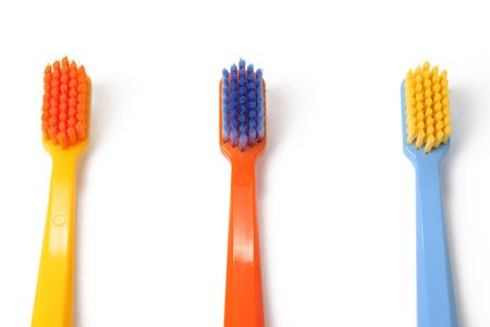 color toothbrush on white background Stock Photo - 6119100