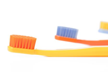 color toothbrush on white background Stock Photo - 6119115