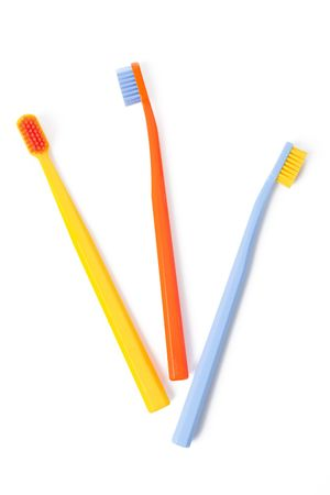 color toothbrush on white background Stock Photo - 6119107