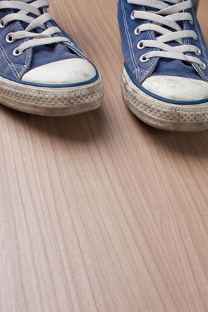 pair of blue sneakers on wooden floor Stock Photo - 6119147